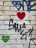 Hearts, white wall and graffiti Stock Photo
