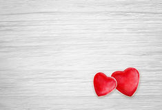 Hearts on white wood background Royalty Free Stock Photography