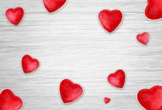 Hearts on white wood background Royalty Free Stock Images