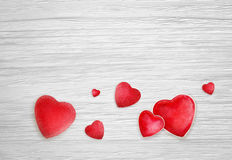 Hearts on white wood background Stock Photo