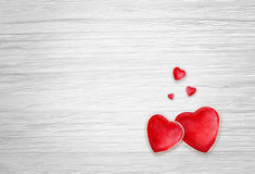 Hearts on white wood background Stock Photos