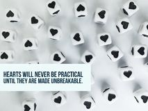 Hearts will never be practical until they are made unbreakable inspirational quote. Or motivational motto background stock photo