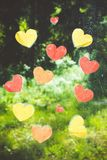 Hearts on the window. Hearts on the window after the rain. Against the background, you can see a forest. These hearts symbolize the love of nature stock photos
