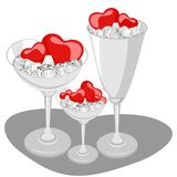 Hearts in a wine glass with ice cube. Stock Images