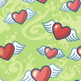 Hearts with wings on a green background Royalty Free Stock Photography