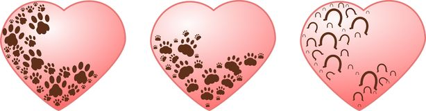 Hearts wit paws. Pink heart decorated with brown paws of dog, cat and horse Royalty Free Stock Image