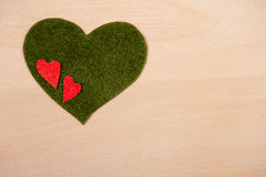 Hearts on  wooden background Stock Photography