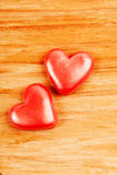 Hearts on wooden background Royalty Free Stock Images