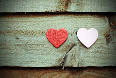 Hearts on wooden background. Two hearts on wooden background royalty free stock photo
