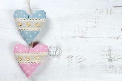 Hearts on wooden background. Two hearts on wooden background stock photography