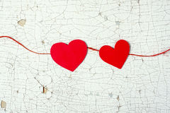 Hearts on the wooden background. Two red hearts made of paper on a wooden background Royalty Free Stock Photography