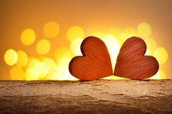 Hearts on a wooden branch and background is a bokeh. Valentines day concept stock images