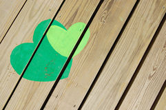 Hearts on wooden floor Stock Photography