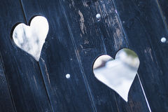 Hearts on a wooden gate Stock Images