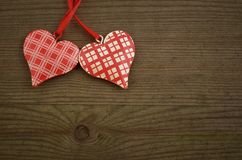 Hearts on Wooden Texture. Valentines Day background Stock Image
