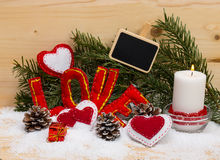 Hearts and the word love made of cloth with burning candle. Stock Photos