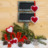 Hearts and the word love made of cloth with burning candle. Royalty Free Stock Images