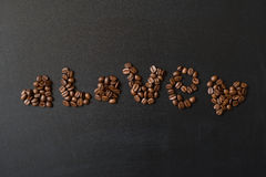 Hearts and word love written by coffee beans Stock Images