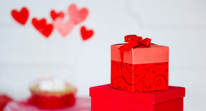 Hearts and wrapped present box Stock Photo