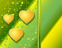 Hearts yellow on a green patten background Royalty Free Stock Image