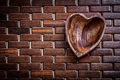 Heartshaped bowl on wooden matting food and drink concept Royalty Free Stock Photography