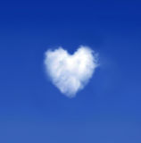 Heartshaped cloud. On a blue sky stock images