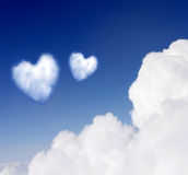 Heartshaped cloud. S in the blue sky stock images