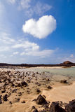 Heartshaped cloud above lagoon. Heart-shaped cloud over the island of Los Lobos, near Fuerteventura stock images