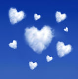 Heartshaped clouds Stock Photography