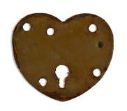Heartshaped keyhole. Rusty heartshaped keyhole isolated on white Royalty Free Stock Images
