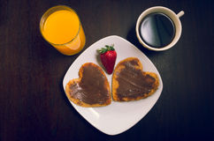 Heartshaped pancakes covered with chocolate and royalty free stock photos