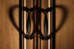Heartshaped shadows from closet door pull handles Stock Image
