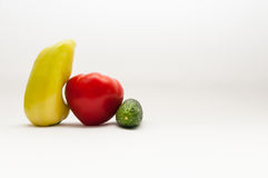 Heartshaped tomato. Between a paprika and a cucumber isolated on white backgound stock photo
