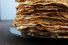 Hearty beautiful pancakes on wooden table royalty free stock photo