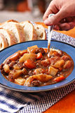 Hearty beef stew. Picture of eating some hearty beef stew stock photo