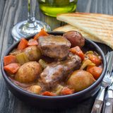 Hearty beef stew with carrot, celery, shallot and potato, square. Format royalty free stock images