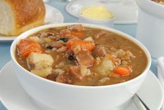 Hearty bowl of soup. A bowl of hearty ham and bean soup or stew stock images