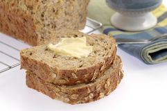 Hearty Bread. Slices of homemade hearty bread with butter stock photo