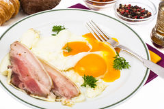 Hearty breakfast with bacon and fried eggs Stock Photo