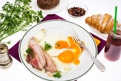 Hearty breakfast with bacon and fried eggs Royalty Free Stock Image