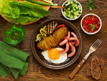 A hearty breakfast of baked potatoes (accordion) Royalty Free Stock Images
