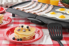 Hearty breakfast cooking on the grill Royalty Free Stock Image