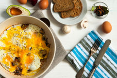 Hearty breakfast: plate of fried eggs and royalty free stock photos