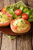 Hearty breakfast: poached eggs with salmon and hollandaise sauce Royalty Free Stock Photography