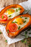 Hearty breakfast: sweet potato stuffed with egg and tomato close stock photography