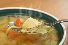 Hearty Chicken Noodle Soup. A steaming hot bite of some hearty chicken noodle soup royalty free stock images