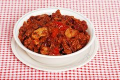 Hearty chili. On red and white tablecloth royalty free stock photos