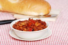 Hearty Chili With Loaf Of Bread Stock Photos