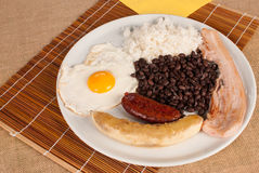 Hearty Colombian lunch. Portion of bandeja paisa, a hearty Colombian lunch Royalty Free Stock Image