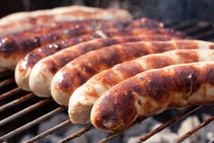Hearty cookout. Grill hotdogs finished grilling on a charcoal grill Stock Images